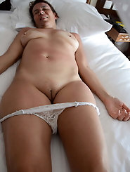 Young-looking mature businesswoman is masturbating herself